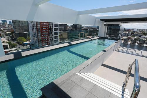 The swimming pool at or near Alex Perry Hotel & Apartments