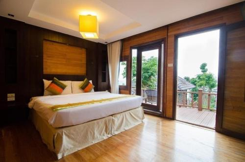 A bed or beds in a room at Phi Phi The Beach Resort- SHA Certified