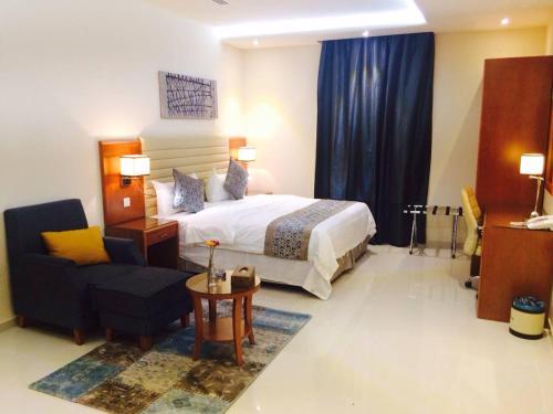 Cama ou camas em um quarto em Pestana Hotel & Suites 1