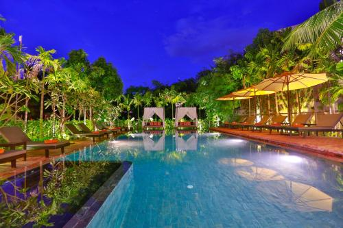 The swimming pool at or near Home Indochine D'angkor