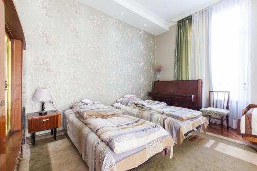 Кровать или кровати в номере Nino Shavhaleti Guest House