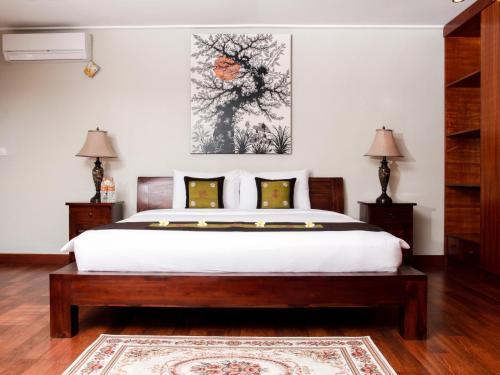 A bed or beds in a room at Linda Villa Sanur