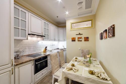 Кухня или мини-кухня в Бутик Отель Дамари