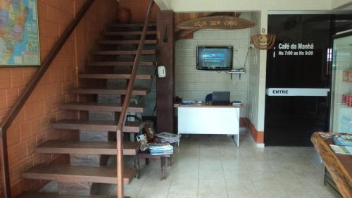 The lobby or reception area at Chalé Apart Hotel