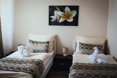 Posteľ alebo postele v izbe v ubytovaní Apartmany Fonte