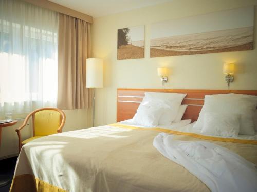 Łóżko lub łóżka w pokoju w obiekcie Hotel Nadmorski