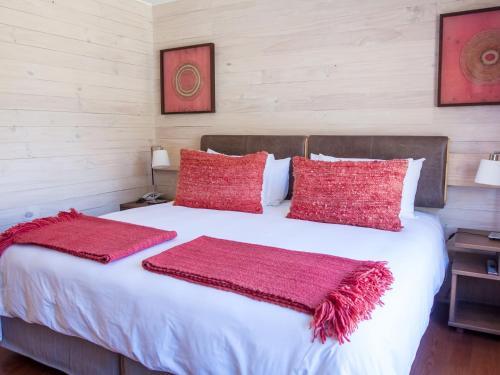 Cama o camas de una habitación en NOI Puma Lodge