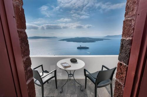 A balcony or terrace at Aigialos Luxury Traditional Settlement