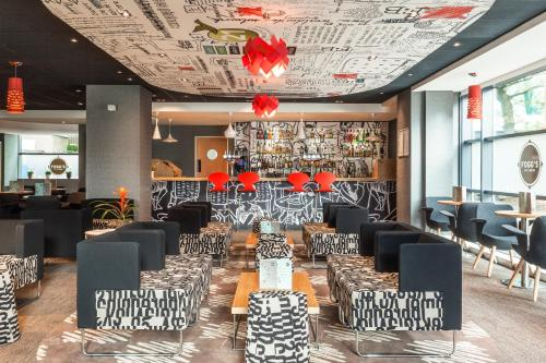 A restaurant or other place to eat at ibis London Wembley