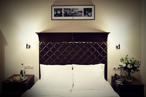 Кровать или кровати в номере 11 Hotel & Garden Boutique Hotel
