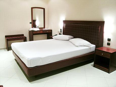 A bed or beds in a room at Brazil Hotel