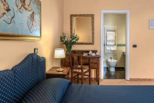 A television and/or entertainment center at Hotel Caracciolo