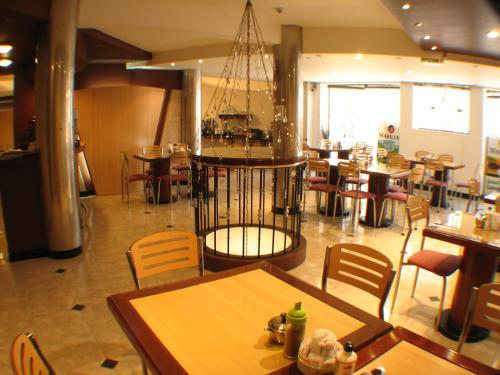 A restaurant or other place to eat at Hotel Marilian
