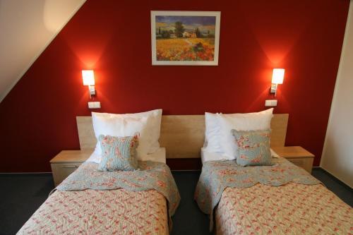 Ein Bett oder Betten in einem Zimmer der Unterkunft Hotel Chvalská Tvrz