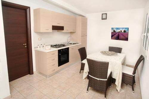 A kitchen or kitchenette at Green Paradise Resort