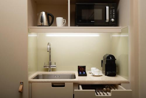 A kitchen or kitchenette at The Resident Victoria
