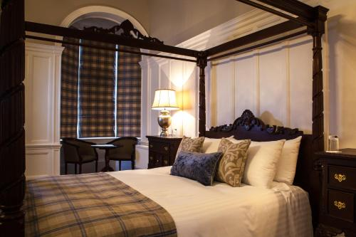 A bed or beds in a room at Inglewood House and Spa