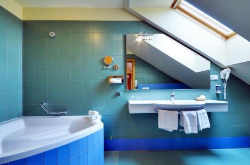 Ванная комната в Hotel Filipinum