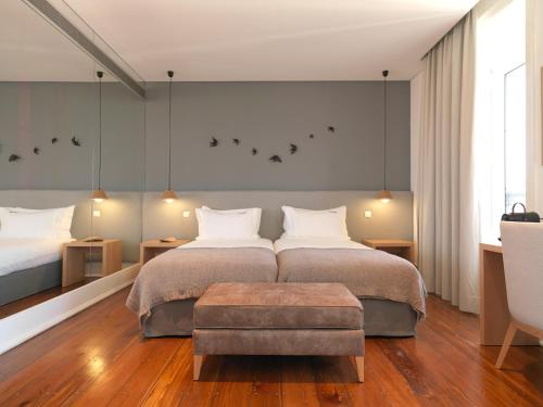 A bed or beds in a room at Feels Like Home Chiado Prime Suites