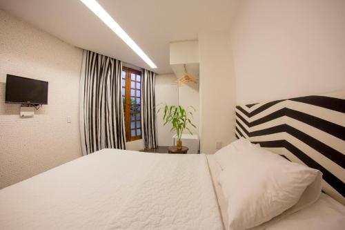 Cama ou camas em um quarto em Vivaz Boutique Hotel