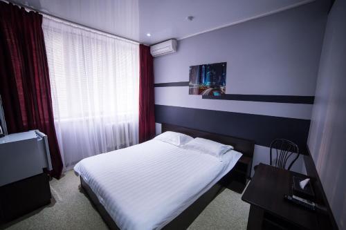 Кровать или кровати в номере Гостиница Сити