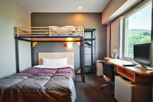 A bunk bed or bunk beds in a room at Super Hotel Arai Niigata