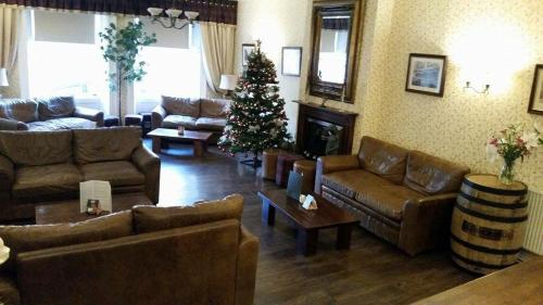 The lobby or reception area at The Royal Hotel Tain