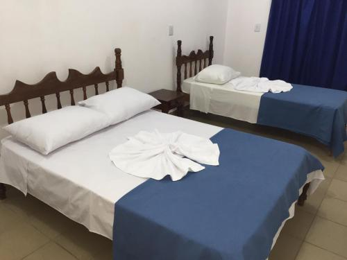 A bed or beds in a room at Romax Hotel