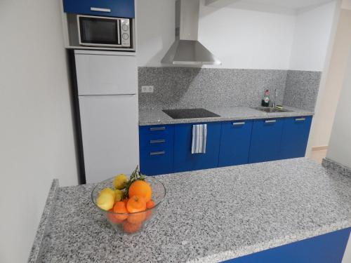 A kitchen or kitchenette at Apartamentos La Rosita
