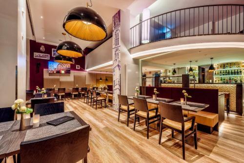 Ein Restaurant oder anderes Speiselokal in der Unterkunft CityClass Hotel Residence am Dom