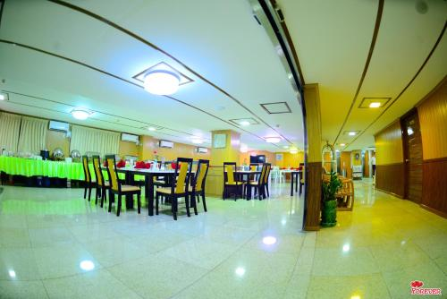 A restaurant or other place to eat at Vega Star Hotel