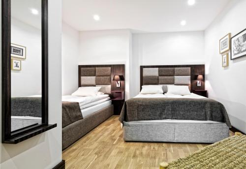 A bed or beds in a room at Sofo Hotel