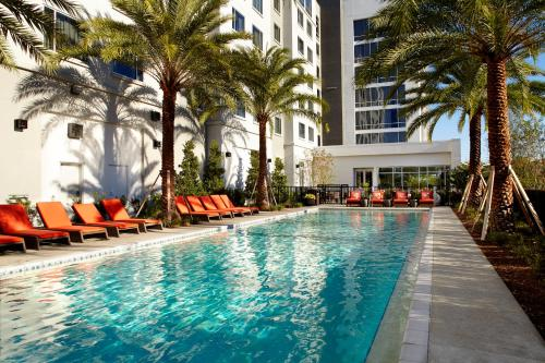 The swimming pool at or close to Courtyard by Marriott Orlando Lake Nona