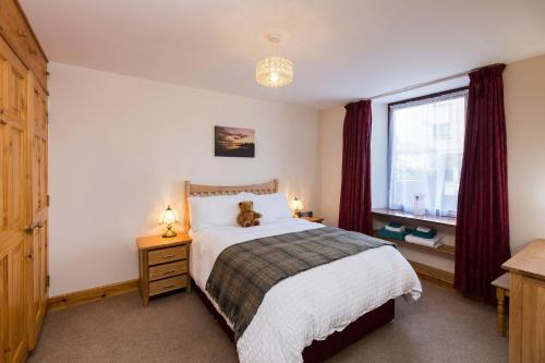 A bed or beds in a room at Corbie Self Catering Shetland