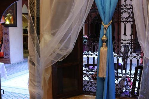 Ein Balkon oder eine Terrasse in der Unterkunft Riad Rêves D'orient