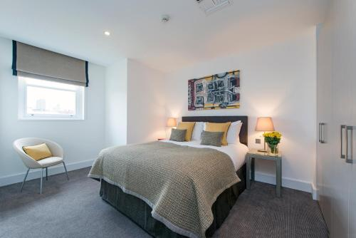 A bed or beds in a room at The Rosebery by Supercity Aparthotels