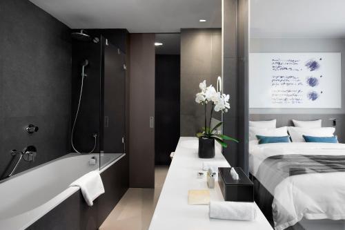 Ein Badezimmer in der Unterkunft Hotel Cubo