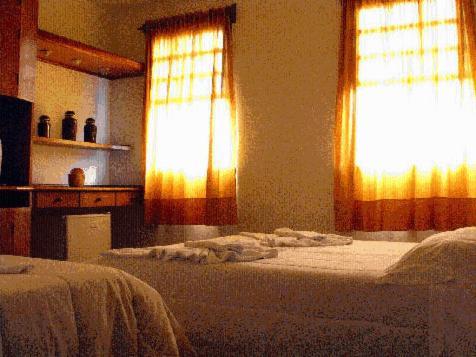 Cama ou camas em um quarto em Pousada Sempre Viva