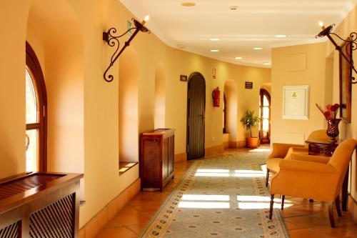 The lobby or reception area at TUGASA Hotel Castillo de Castellar
