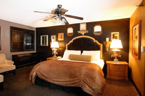 A bed or beds in a room at The Artisan Boutique Hotel - Adult Only