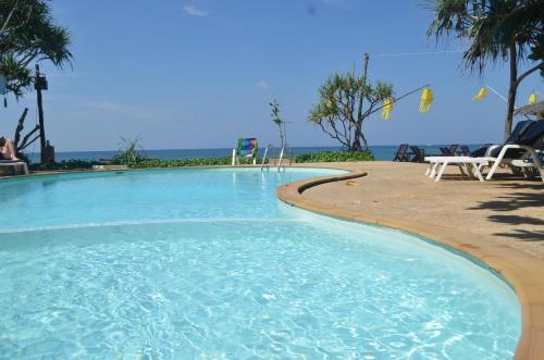The swimming pool at or near Lanta Nice Beach Resort