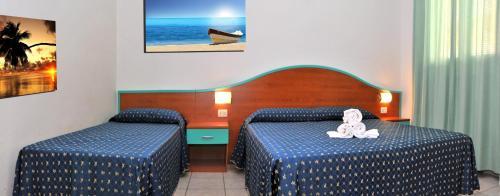 Postel nebo postele na pokoji v ubytování Isola di Pasqua