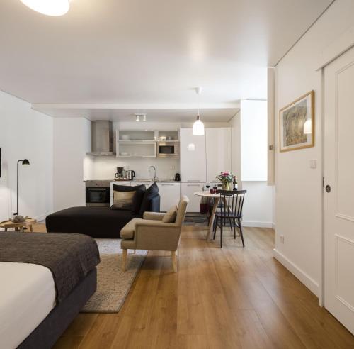 Een zitgedeelte bij Lisbon Serviced Apartments - Baixa Castelo