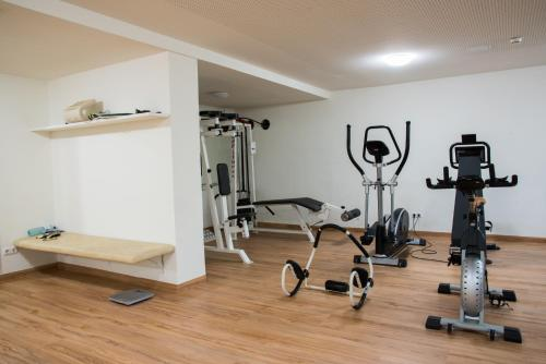 Das Fitnesscenter und/oder die Fitnesseinrichtungen in der Unterkunft Boutique Hotel Erla