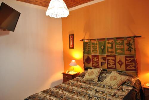 A bed or beds in a room at Departamentos Betania