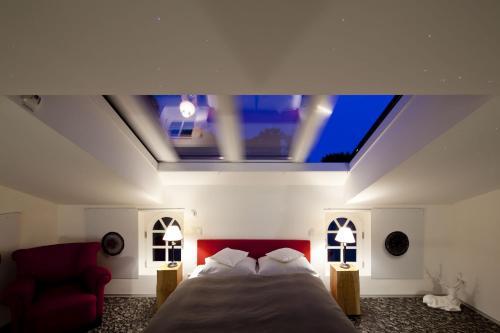 Ein Bett oder Betten in einem Zimmer der Unterkunft Hotel Schloss Hertefeld