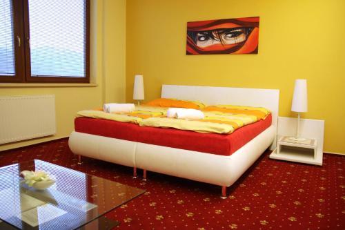 Postel nebo postele na pokoji v ubytování Vila Jiřinka