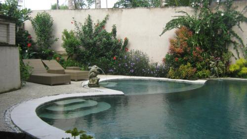The swimming pool at or near Mahanadewi Villa