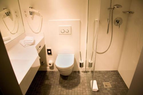 Ein Badezimmer in der Unterkunft BURNS Art Cologne