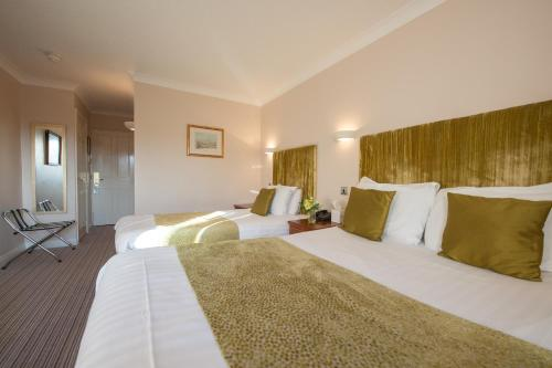 A bed or beds in a room at The Minster Hotel
